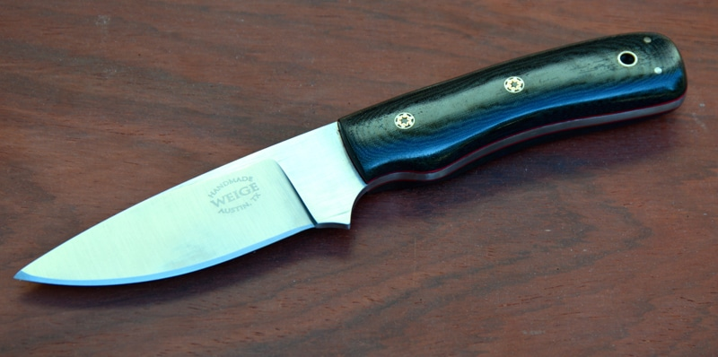 Custom drop point knife in black linen micarta and handmade mosaic pins.