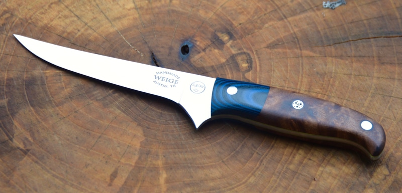 Custom boning knife in Texas madrone w/ blue and black G10 handle.