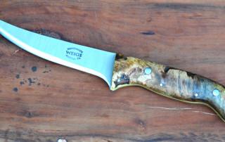Custom boning knife w/ mango burl handle and yellow liner.