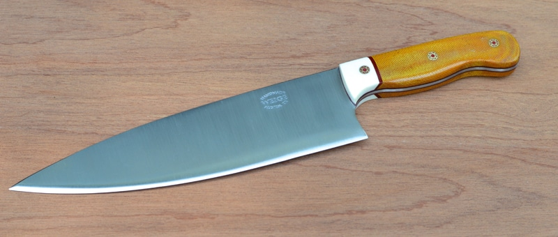 Custom chef knife in natural linen w/ a white paper linen bolster and red liner.