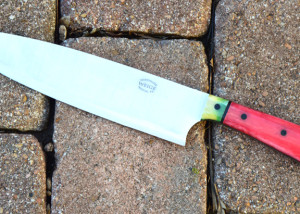 The watermelon knife. Handle is red and green camel bone w/ black linen pins.
