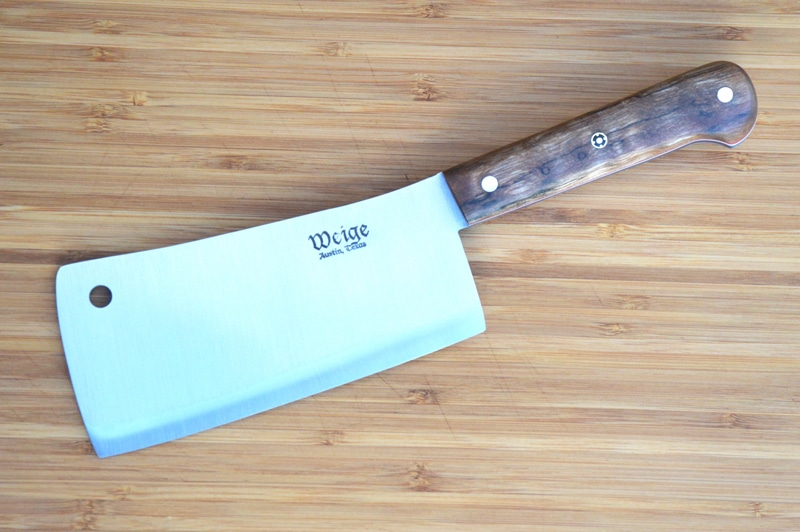 Custom cleaver in TX oak. Red, white and blue liner w/ brass pins.