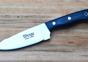 Custom outdoor knife w/ blue and black G10 handle and solid stainless pins.