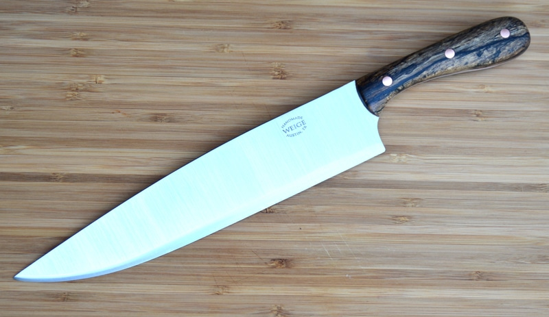 10 inch blade custom chef in Texas pecan and copper pins.
