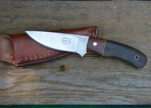 Custom drop point in green canvas w/ a mahogany bolster. yellow liner and solid stainless pins.