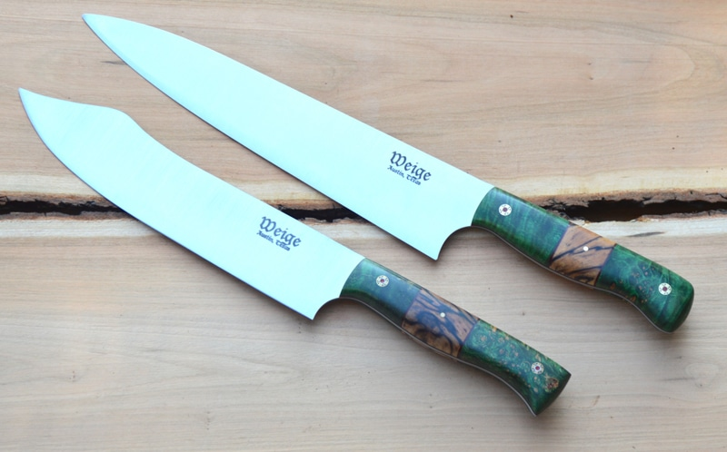 Set of 2 knives in green maple and natural maple w/ red liner and red mosaic pins. Bull nose butcher and french cut chef.