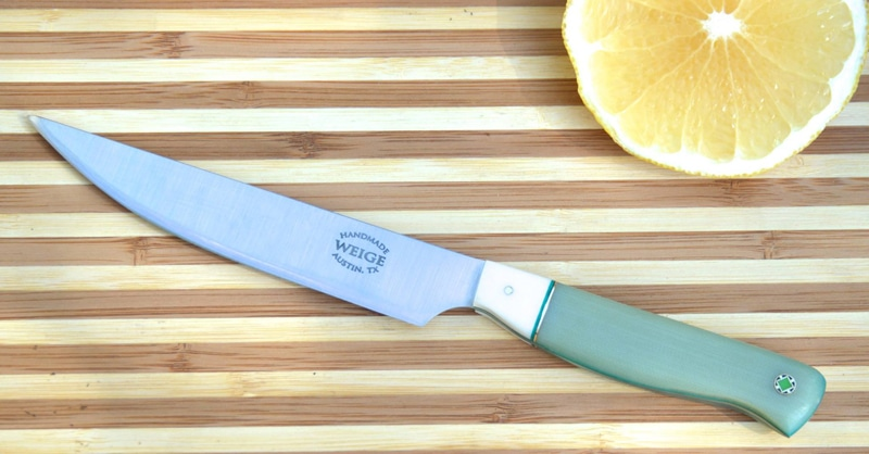 Steak knife in jade G10 w/ paper micarta bolster. Brass and teal liner w/ handmade mosaic pins in brass and green.