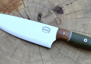 Smaller chef in green canvas w/ a brown linen bolster and grey liner.