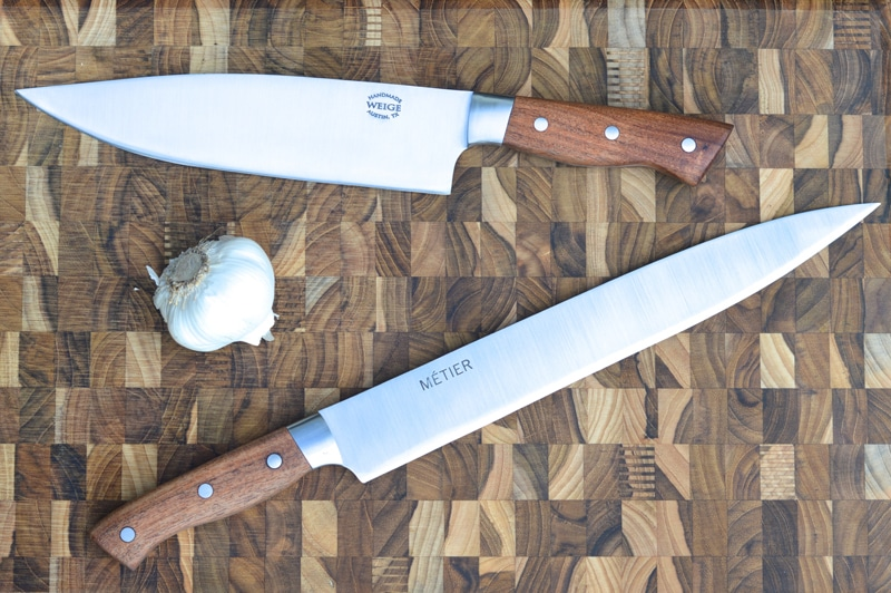 Custom chef and slicing knife in TX mesquite w/ SS bolsters.