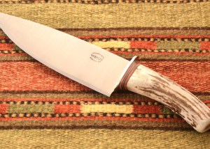 Deer horn handled chef knife w/ leather and stainless washers.