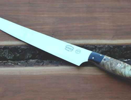Custom slicer in stabilized maple and a dovetailed buffalo horn bolster. Blade is 10 inches and handle is 5.